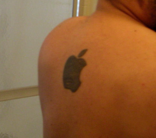 Listener Russ sent in tis picture of his Apple Logo tattoo.